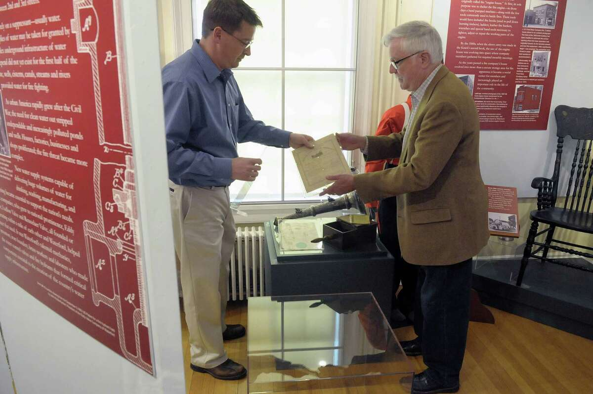 Brad Utter, left, director of the museum and paul Schneider, Jr., a guest curator for the show, work on installing some items into a case at the Waterford Historical Museum and Cultural Center on Thursday, May 3, 2012 in Waterford, NY. The exhibit entitled