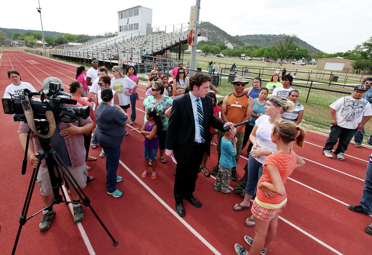 Junction Elementary School parents and students answer questions from the media at Eagle Stadium, Thursday May 3, 2012 in Junction, Tx., where fifth grade students were told by teachers to crawl down the track and meow like cats on Wednesday.