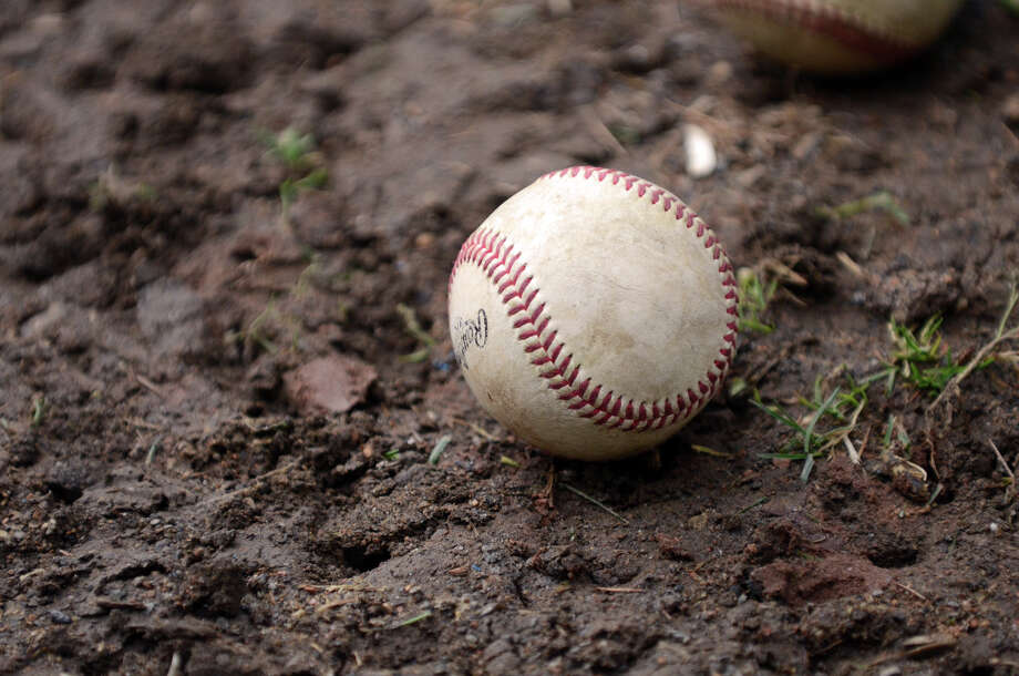 A baseball lies on the ground during the New Canaan vs Fairfield Warde baseball game at Mead Park in New Canaan on Wednesday, May 2, 2012. Photo: Amy Mortensen / Connecticut Post Freelance