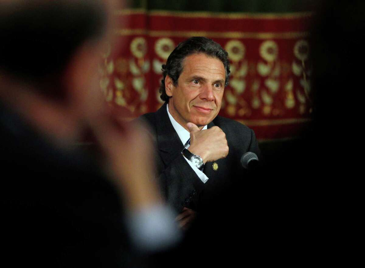 New York Gov. Andrew Cuomo listens to a speaker during a NY Works news conference in the Red Room at the Capitol in Albany, N.Y., on Thursday, May 3, 2012. Cuomo says he?'s considering new ideas to pay for replacing the Tappan Zee Bridge after the federal government rejected a $2 billion loan application. The proposed $5.2 billion Tappan Zee is a high priority for Cuomo. It would build two spans to replace an aging, overcrowded bridge across the Hudson in New York City's suburbs. (AP Photo/Mike Groll)