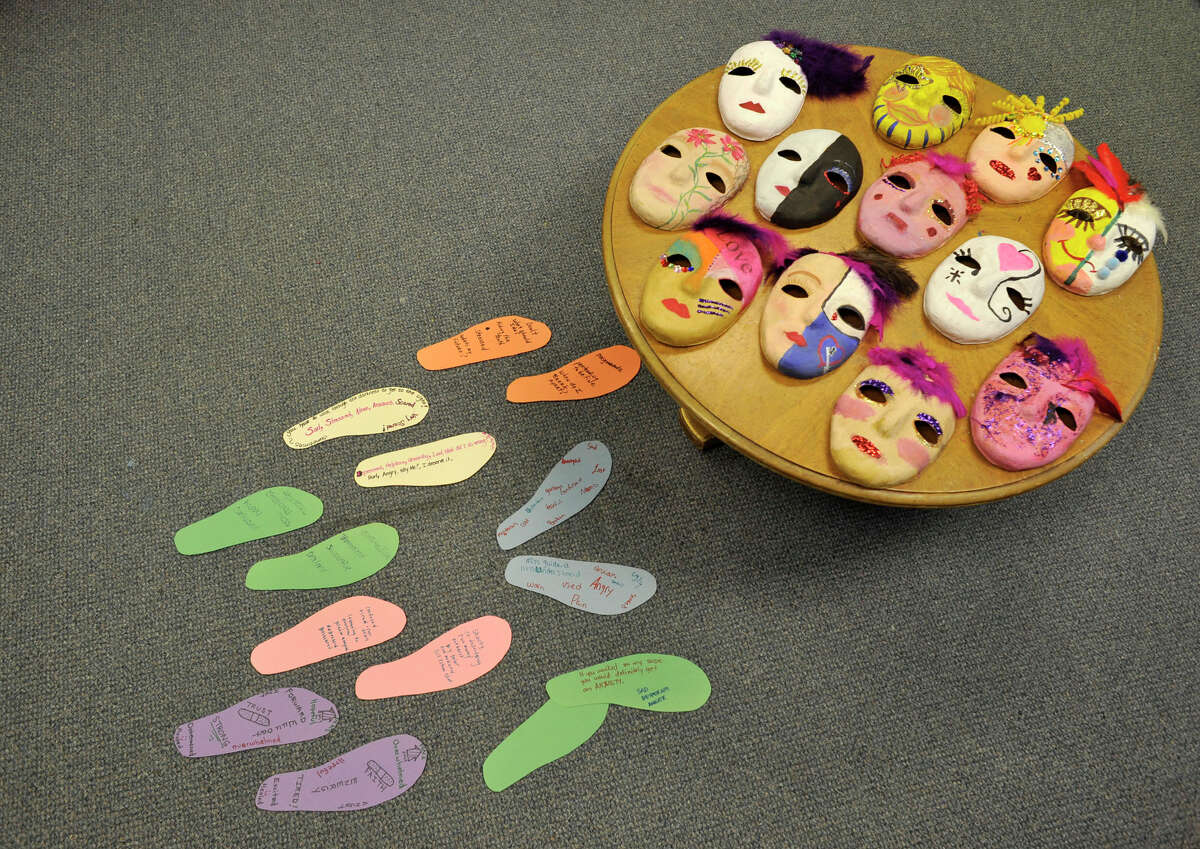 Masks and footprints made by women in the domestic violence support group are shown at the Women's Center of Greater Danbury on Thursday, May 3, 2012. The masks represent what the victim is showing the world, while also showing what is going on on the inside. The footprints represent what it means to walk in the victim's shoes. Scaros-Mercado is a drama therapist and licensed creative arts therapist.