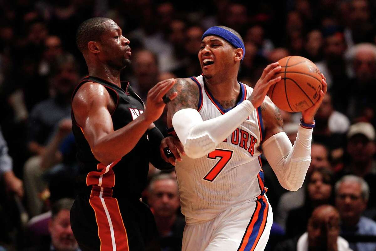 Carmelo Anthony of the Knicks looks to pass while being defended by Miami's Dwyane Wade during Thursday's playoff game.