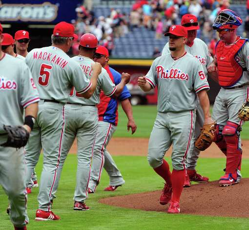 ATLANTA, GA - MAY 3: Joe Blanton #56 of the Philadelphia Phillies is congratulated by teammates after the game against the Atlanta Braves at Turner Field on May 3, 2012 in Atlanta, Georgia. Photo: Scott Cunningham, Getty Images / 2012 Getty Images