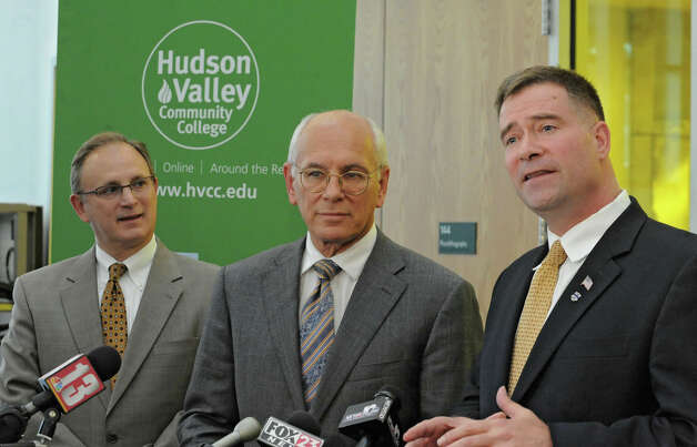 From left, Andrew Matonak, president of Hudson Valley Community College Congressmen Paul Tonko and Chris Gibson talk about President Barack Obama's upcoming visit on Tuesday to GlobalFoundries Thursday, May 3, 2012 in Malta, N.Y. The press conference was held at the HVCC Tech and Energy Park. (Lori Van Buren / Times Union) Photo: Lori Van Buren