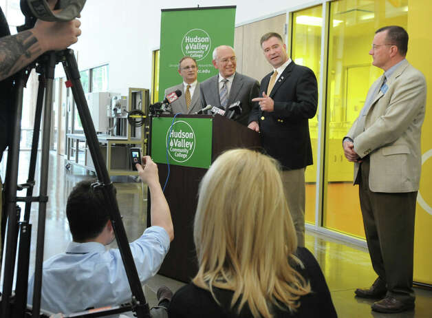 From left, Andrew Matonak, president of Hudson Valley Community College Congressmen Paul Tonko and Chris Gibson and Pete Bardunias, president/CEO Chamber of Southern Saratoga County, talk about President Barack Obama's upcoming visit on Tuesday to GlobalFoundries Thursday, May 3, 2012 in Malta, N.Y. The press conference was held at the HVCC Tech and Energy Park. (Lori Van Buren / Times Union) Photo: Lori Van Buren