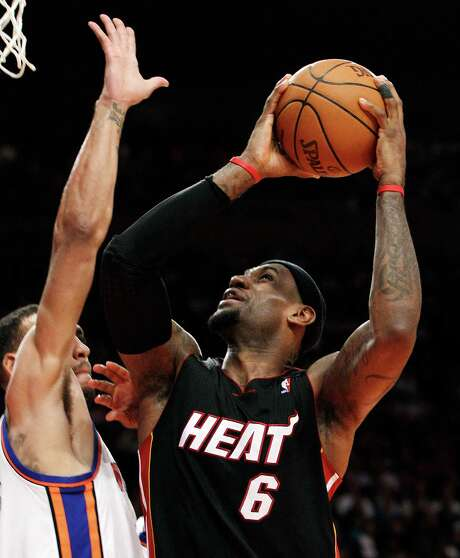 Miami's LeBron James (right) scored 17 of his 32 points in the third quarter. Photo: AP