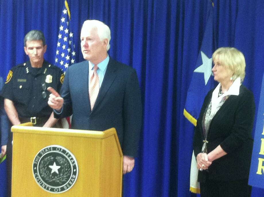 U.S. Sen John Cornyn, R-Texas, promotes his new Sexual Assault Forensic Evidence Registry (SAFER) Act proposal during a press conference Thursday, May 3, 2012, at the Bexar County District Attorney's Office. He is joined by San Antonio Police Chief William McManus (left) and District Attorney Susan Reed. Photo: Craig Kapitan, San Antonio Express-News