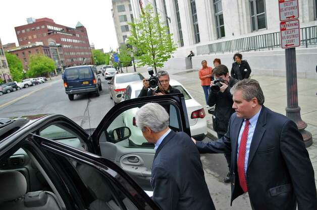Former Senate Majority Leader Joseph Bruno, left, enters a vehicle with his son Kenneth, right, as they leave U.S. District Court after the elder Bruno was indicted for a second time on Thursday afternoon May 3, 2012 in Albany, N.Y. (Philip Kamrass / Times Union) Photo: Philip Kamrass / 00017549A