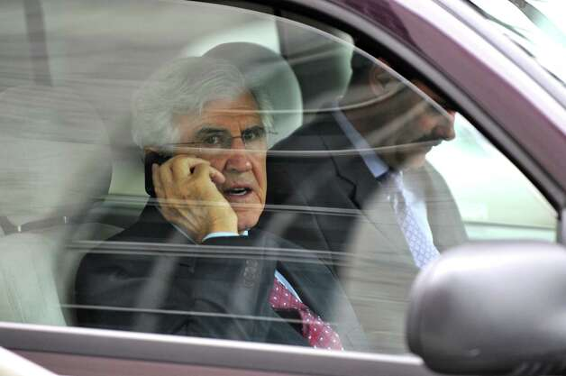 Former Senate Majority Leader Joseph Bruno talks on a phone after reading a sheaf of papers while waiting for his attorneys to complete a nearby press conference on the steps of the U.S. District Court before they returned to the vehicle,  after Bruno was indicted for a second time on Thursday afternoon, May 3, 2012 in Albany, N.Y. (Philip Kamrass / Times Union) Photo: Philip Kamrass / 00017549A