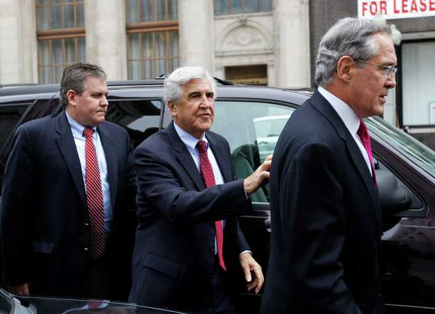 Former state Sen. Joseph Bruno, center, arrives to federal court in Albany, N.Y., with his son Kenneth Bruno, left, and attorney E. Stewart Jones, on Thursday, May 3, 2012. Defense attorney William Dreyer says he and Bruno have been told be in court Thursday, but haven't been told why. Federal prosecutors have said they'd pursue a new indictment after the appeals court last year rejected convictions of Bruno, now 83, on two counts of honest services fraud. (AP Photo / Mike Groll) Photo: Mike Groll / AP