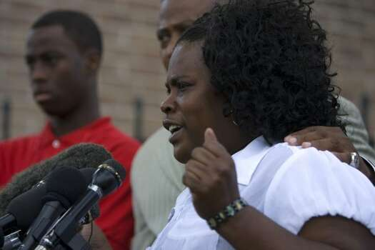 Joyce Holley, (right) mother of Chad Holley, 15, (left) explains how she found out her son was allegedly beaten up by Houston police officers during a press conference outside the South Chase Apartment complex Thursday, April 29, 2010, in Houston.