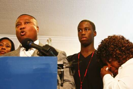 Chad Holley (second from right) stands beside his mother, Joyce Holley (right) as Minister Quanell X (left) describes the events surrounding the alleged beating of Chad Holley after an encounter with eight Houston police officers in March, during a press conference Tuesday, May 4, 2010, in Houston with members of the NAACP, S.H.A.P.E. Community Center, the Nation of Islam, Ministers Against Crime, the National Black United Front and other community leaders, to release graphic images of injuries sustained by Holley.