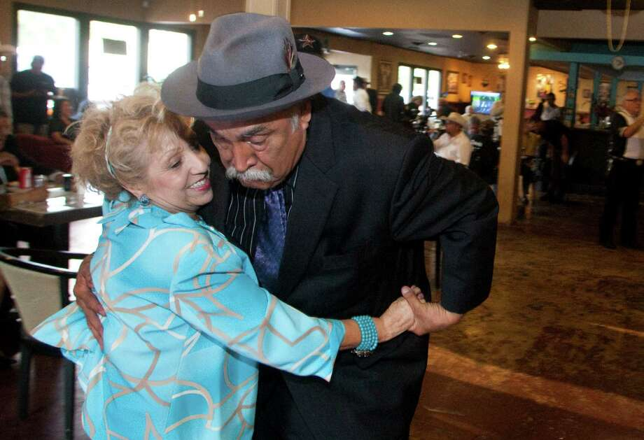 Carlos Calbillo and Lolita Guerrero dance at a reception announcing the Tony Cavazos Bruni Memorial Scholarship at the Sombreros Coffee Shop. Photo: J. Patric Schneider / Houston Chronicle