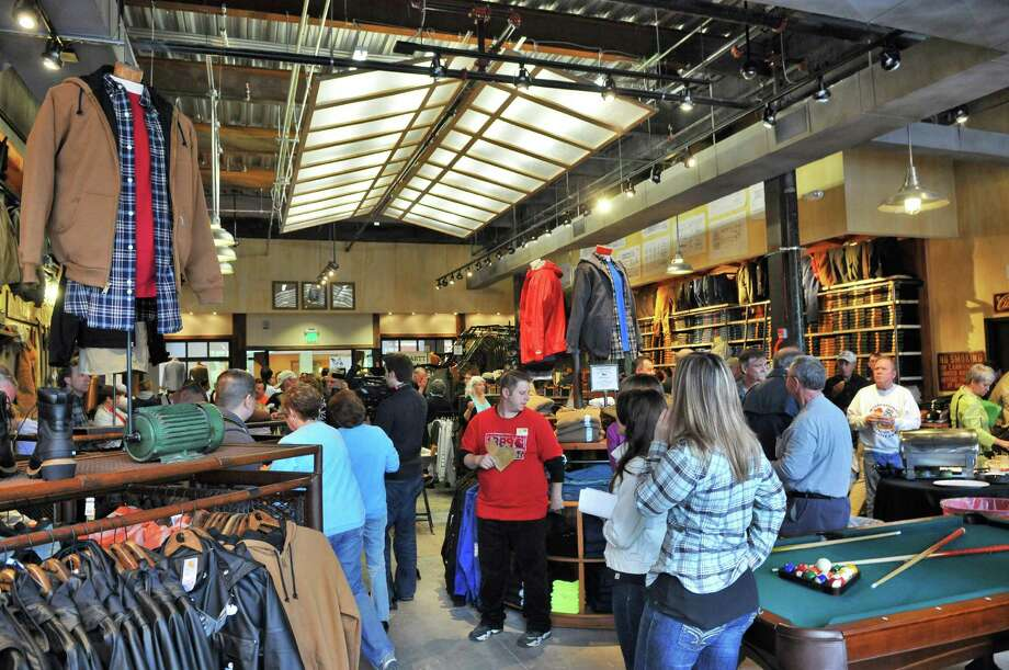 Customers inside Carhartt's first upstate store's grand opening at Crossgates Mall in Guilderland Thursday May 3, 2012.  (John Carl D'Annibale / Times Union) Photo: John Carl D'Annibale / 00017490A