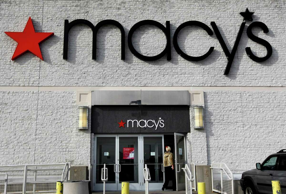 FILE - In this Nov. 3, 2011, file photo, a person enters a Macy's department store in North Attleboro, Mass. Macy's Inc. said Thursday, May 3, 2012, that revenue at stores open at least a year increased 1.2 percent in April, but fell short of Wall Street's expectations. (AP Photo/Steven Senne, File)