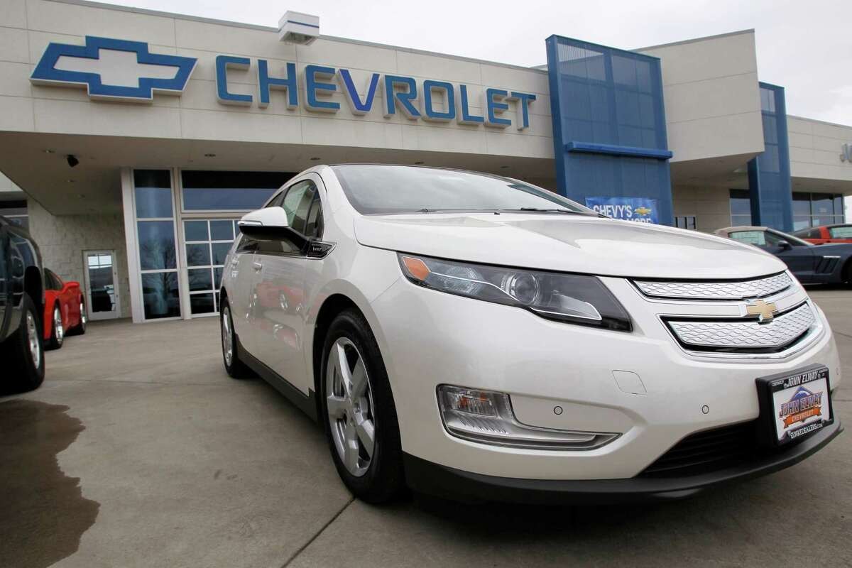 FILE- This Feb. 19, 2012, file photo, shows a 2012 Chevrolet Volt outside at a Chevrolet dealership in the south Denver suburb of Englewood, Colo. General Motors reported on Thursday, May 3, that it earned $1 billion in the first quarter but losses in Europe and a big charge weighed on results. (AP Photo/David Zalubowski, File)