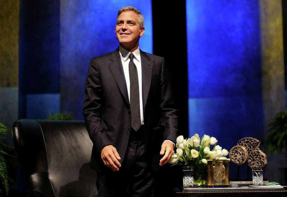 George Clooney smiles at the crowd after he was introduced at the Brilliant Lecture Series at the Wortham Theater Thursday May 3,2012. (Dave Rossman Photo) Photo: Dave Rossman, For The Chronicle / © 2012 Dave Rossman