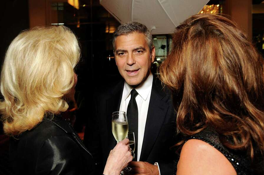 George Clooney chats with Lynn Wyatt and Cherie Flores before his appearance at the Brilliant Lectur