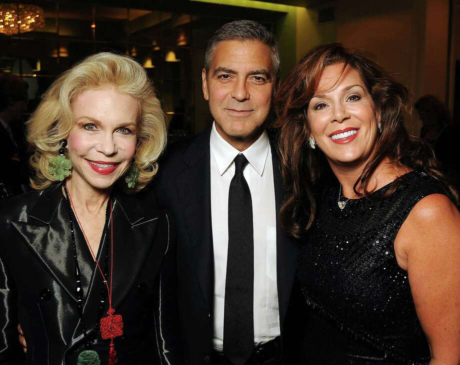 From left: Lynn Wyatt, Geroge Clooney and Cherie Flores at the VIP reception before Clooney's appearance at the Brilliant Lecture Series at the Wortham Theater Thursday May 3,2012. (Dave Rossman Photo) Photo: Dave Rossman, For The Chronicle / © 2012 Dave Rossman