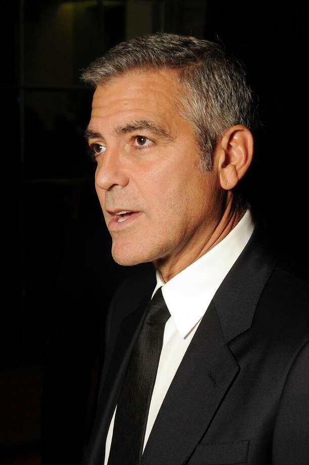 George Clooney speaks to the media before his  appearance at the Brilliant Lecture Series at the Wortham Theater Thursday May 3,2012. (Dave Rossman Photo) Photo: Dave Rossman, For The Chronicle / © 2012 Dave Rossman