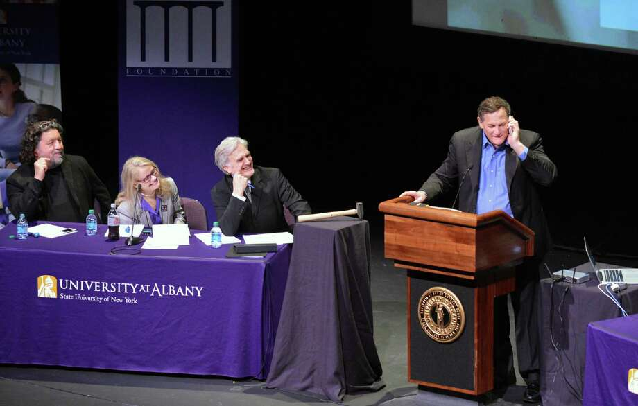 Co-founder of Tribeca Film Festival, Craig Hatkoff, at right, takes a cell phone call during a panel discussion on local film production at UAlbany Thursday May 3, 2012.  From left are Philip Morris, CEO of Proctors, Patricia Swinney Kaufman, executive director of the New York State Governor's Office for Motion Picture and Television Development and Times Union editor Rex Smith.  (John Carl D'Annibale / Times Union) Photo: John Carl D'Annibale / 00017538A