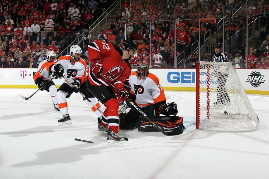 Alexei Ponikarovsky (12) scores the game-winning goal in overtime for the Devils. Photo: Bruce Bennett, Getty Images / 2012 Getty Images