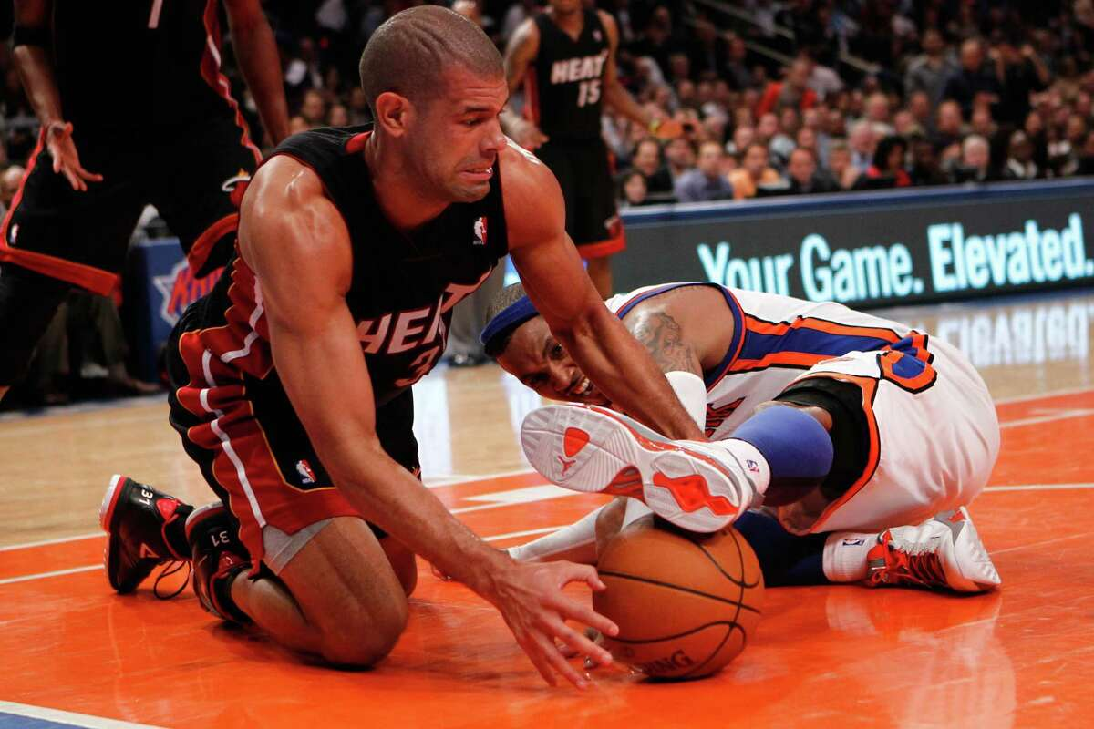 NEW YORK, NY - MAY 03: Shane Battier #31 of the Miami Heat fights for control of a loose ball in the third quarter against Carmelo Anthony #7 of the New York Knicks in Game Three of the Eastern Conference Quarterfinals in the 2012 NBA Playoffs on May 3, 2012 at Madison Square Garden in New York City. NOTE TO USER: User expressly acknowledges and agrees that, by downloading and or using this photograph, User is consenting to the terms and conditions of the Getty Images License Agreement. (Photo by Jeff Zelevansky/Getty Images)