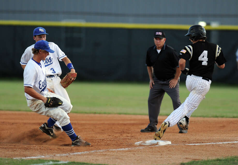 Nederland's Seth Barrow steps safely onto first base against Barbers Hill at the Bulldog's stadium Thursday night. Photo taken Thursday, May 3, 2012 Guiseppe Barranco/The Enterprise Photo: Guiseppe Barranco, STAFF PHOTOGRAPHER / The Beaumont Enterprise