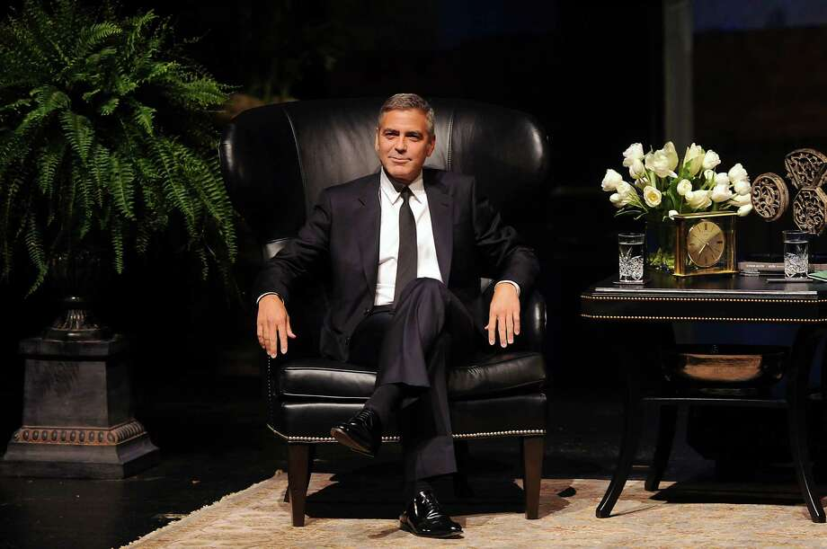 George Clooney fielded questions from the crowd at the Wortham Center. Photo: Dave Rossman / © 2012 Dave Rossman