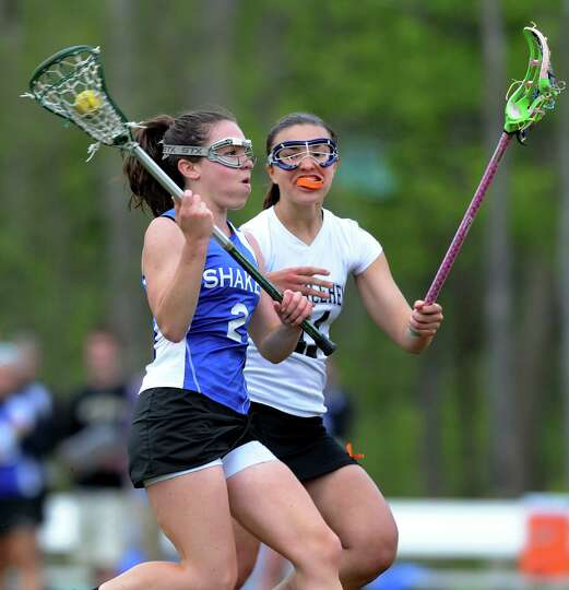 Shaker's Anne Rehfuss (2), left, controls the ball as Bethlehem's Emma Cremo (11) defends during the
