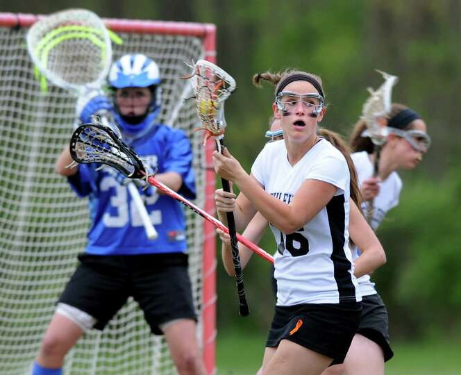 Bethlehem's Megan Duffy (16), right, looks for support during their lacrosse game against Shaker on