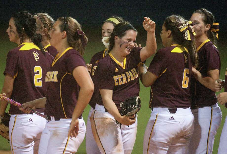 Deer Park Haley Harrison (middle) celebrates with her teammates  after defeating Clements 8-0 in the District 23-5A playoff matchup at Manvel High School on Thursday, May 3, 2012 in Manvel, Texas. Photo: J. Patric Schneider, For The Chronicle / Houston Chronicle