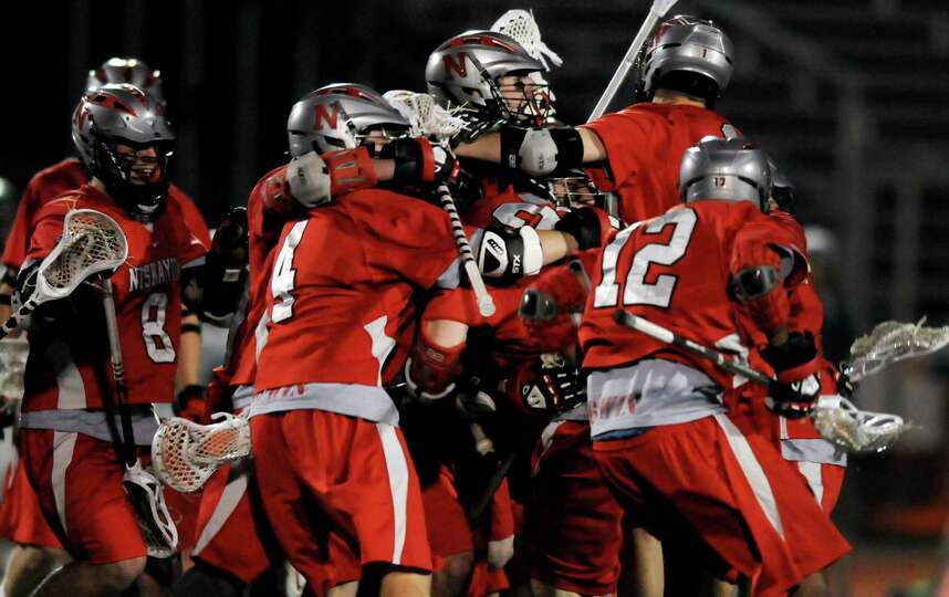 Niskayuna celebrates their 12-11 overtime win against  Shenendehowa during their lacrosse game on Th