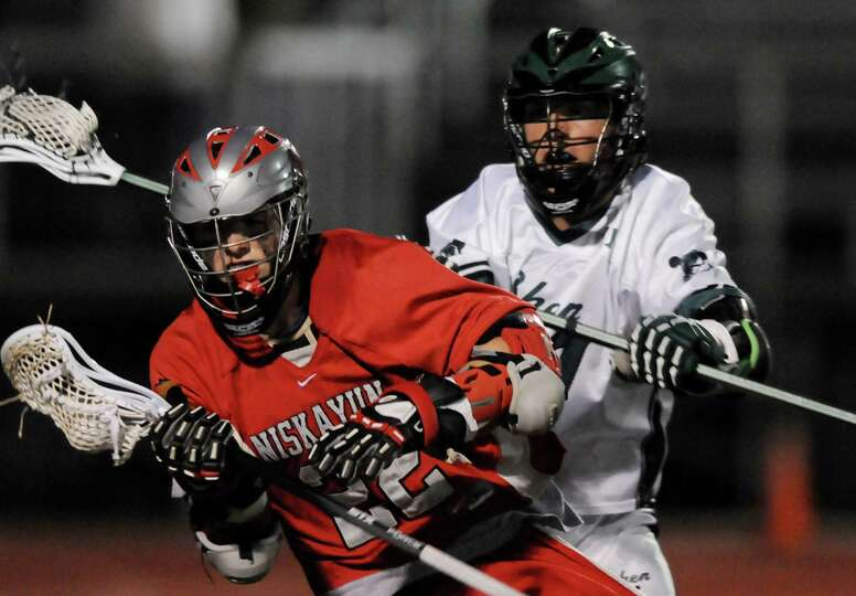 Niskayuna's Matt Sexton (22), left, who scored the winning goal in overtime, controls the ball as Sh