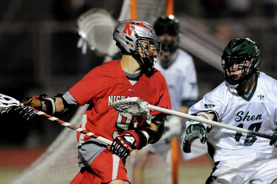 Niskayuna's Luke Goldstock (9), left, (19) looks to shoot against Shenendehowa's Ian Grey during their lacrosse game against Shenendehowa on Thursday, May 3, 2012, at Shenendehowa High in Clifton Park, N.Y. (Cindy Schultz / Times Union) Photo: Cindy Schultz /  00017546A