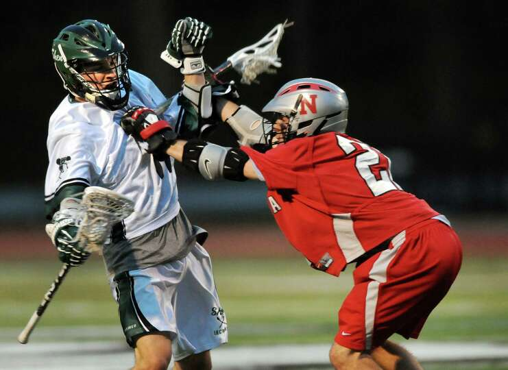 Shenendehowa's Ryan McCart (14), left, controls the ball as Niskayuna's Blake Pfohl (21) defends dur