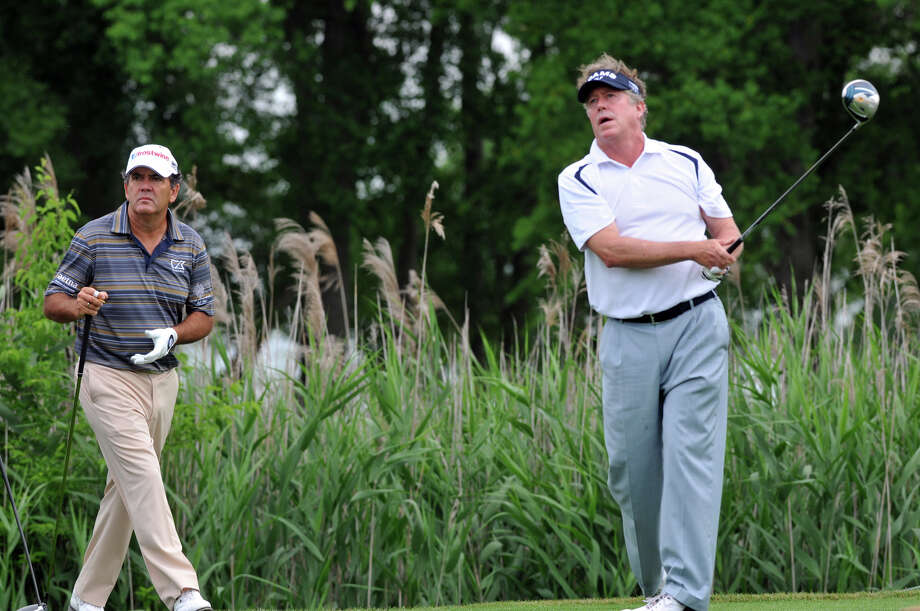 Michael Allen, right, follows through on a tee shot. (AP) Photo: Richard Burkhart, Associated Press / Savannah Morning News