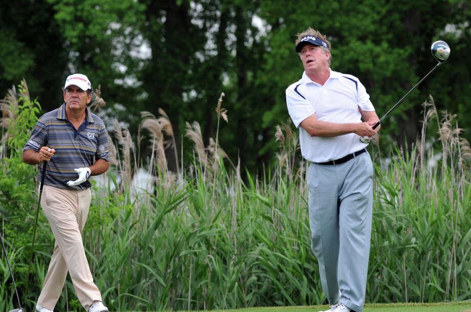 Michael Allen, right, follows through on a tee shot. (AP) Photo: Richard Burkhart, Associated Press / Savannah Morning News
