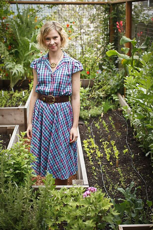"Naya Peterson, seen in her San Francisco, Calif., garden on Tuesday, April 24, 2012, has a company, ""Fire Escape Farms,""  that offers supplies for the urban farmer including a line of seeds being sold by Williams-Sonoma. Photo: Russell Yip, The Chronicle"