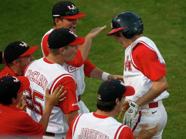 Houston infielder Taylor White, right, was a freshman but played a part in a victory over Rice on May 1, 2009 - the last time the Cougars beat the Owls. Photo: Nick De La Torre / Houston Chronicle
