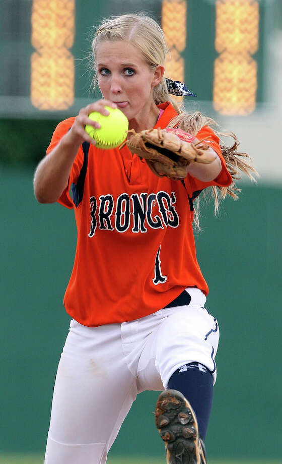 Caleigh Cole cranks into a pitch for the Broncos as Seguin beats Brandeis 6-3 in area softball playoff action at the Northeast Softball Complex on  May 3, 2012.  Tom Reel/ San Antonio EXpress-News Photo: TOM REEL, Express-News / San Antonio Express-News