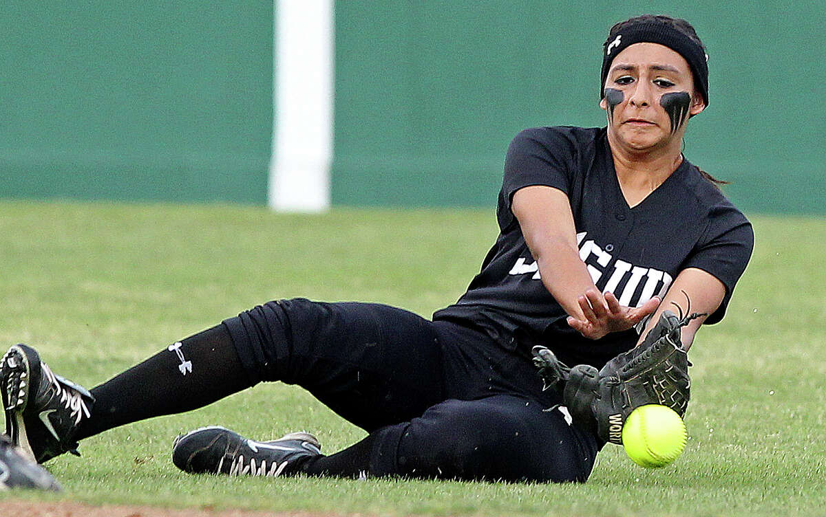 The Matador's Jessica Aguilar narrowly misses a pop up catch as she slides in from the outfield as Seguin beats Brandeis 6-3 in area softball playoff action at the Northeast Softball Complex on May 3, 2012. Tom Reel/ San Antonio EXpress-News