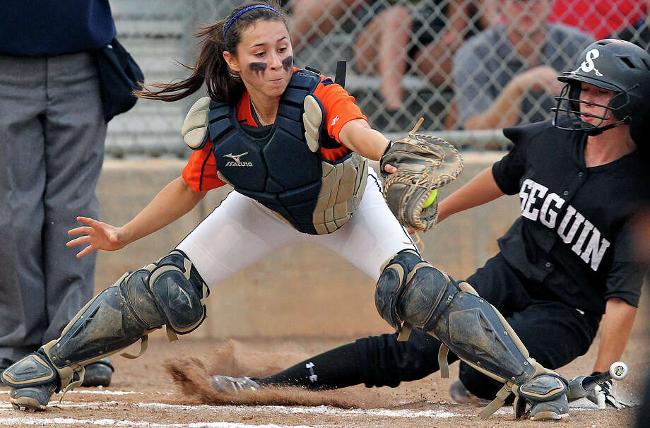 Brandeis catcher Christy Trevino grabs the ball for a force out of Kaycee Govett  at home in the second inning as Seguin beats Brandeis 6-3 in area softball playoff action at the Northeast Softball Complex on  May 3, 2012.  Tom Reel/ San Antonio EXpress-News Photo: TOM REEL, Express-News / San Antonio Express-News