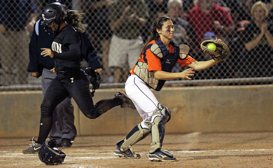 Seguin's Vanesa Lerma streaks across the plate behind Christy Trevino to score the last run as Seguin beats Brandeis 6-3 in area softball playoff action at the Northeast Softball Complex on  May 3, 2012.  Tom Reel/ San Antonio EXpress-News Photo: TOM REEL, Express-News / San Antonio Express-News