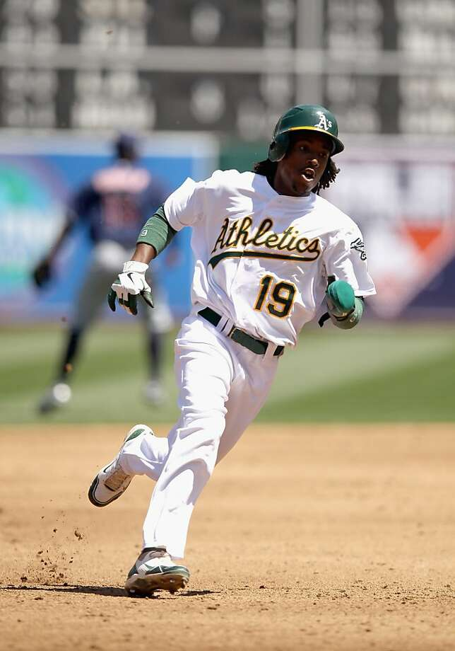 OAKLAND, CA - APRIL 22:  Jemile Weeks #19 of the Oakland Athletics rounds the bases on his way to scoring on a double hit by Cliff Pennington #2 in the third inning of their game against the Cleveland Indians at O.co Coliseum on April 22, 2012 in Oakland, California.  (Photo by Ezra Shaw/Getty Images) Photo: Ezra Shaw, Getty Images
