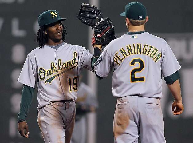 BOSTON, MA - MAY 1:  Jemile Weeks #19 and Cliff Pennington #2 of the Oakland Athletics their 5-3 win over the Boston Red Sox at Fenway Park May 1, 2012  in Boston, Massachusetts. (Photo by Jim Rogash/Getty Images) Photo: Jim Rogash, Getty Images