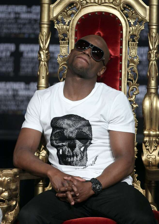 Floyd Mayweather relaxes during a press conference with Miguel Cotto on May 2, 2012 at the MGM Grand in Las Vegas, Nevada.  Mayweather takes on Cotto for the WBA Super World Light Middleweight Championship on Cinco de Mayo, Saturday, May 5, 2012.      AFP PHOTO / John GURZINSKIJOHN GURZINSKI/AFP/GettyImages Photo: John Gurzinski, AFP/Getty Images