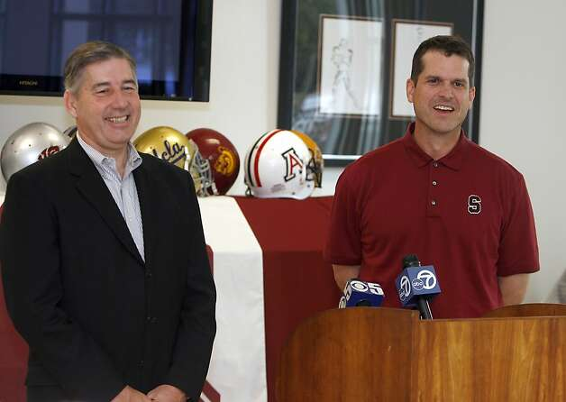 Stanford head football coach Jim Harbaugh, right, and Stanford Athletic Director Bob Bowlsby, left, smile as they address the media during a news conference on Sunday, Dec. 13, 2009, in Stanford, Calif. The school announced a deal on Sunday that keeps Harbaugh under contract through 2014. (AP Photo/Tony Avelar) Photo: Tony Avelar, AP