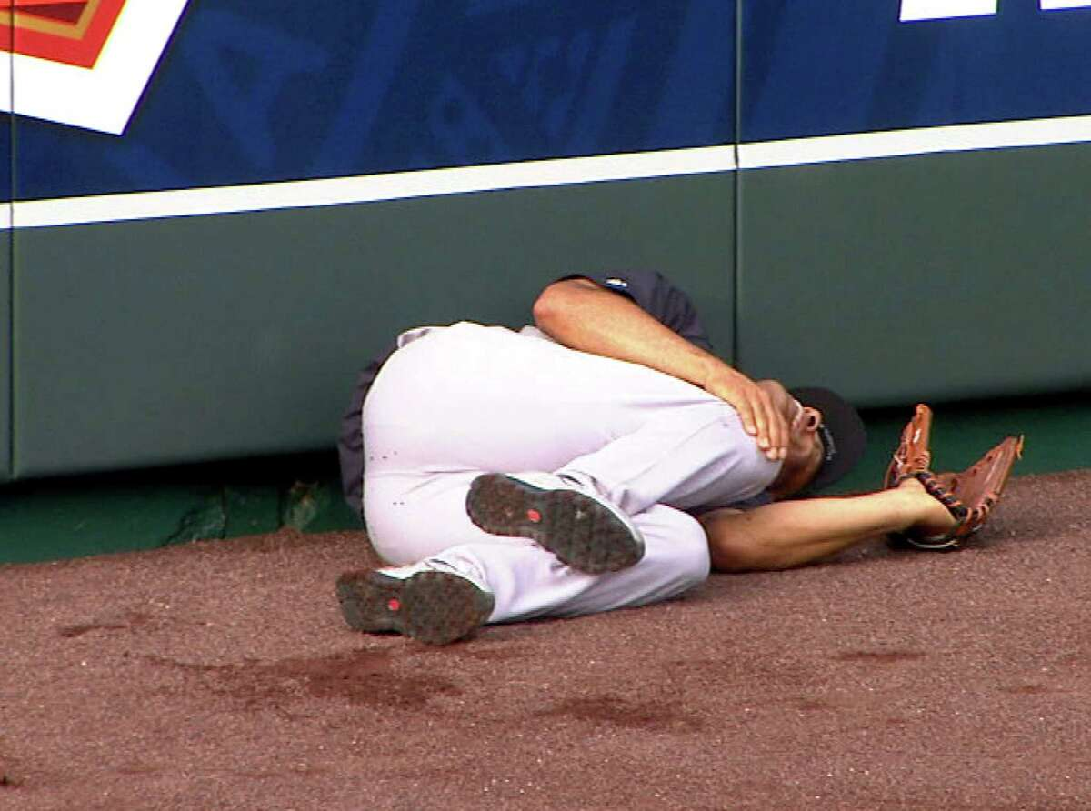 In this image taken from video, New York Yankees' Mariano Rivera lies on the field after twisting his right knee shagging fly balls during batting practice before a baseball game with the Kansas City Royals, Thursday, May 3, 2012, in Kansas City, Mo. The Yankees closer was carted off the field and sent for further tests. (AP Photo/YES Network) MANDATORY CREDIT