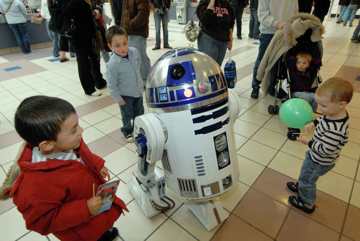Small boys gather around to get a peek at R2D2 one of the Star Wars characters from The 501st Legion's Garrison Excelsior that were on hand ringing bells for the Salvation Army donations at Crossgates Mall on Dec. 6, 2008. (Michael P. Farrell / Times Union Archive)